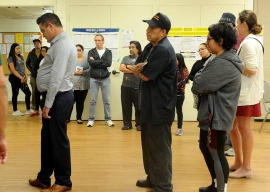 A large group of people waits to vote in the morning at Ventura Avenue Adult Center.