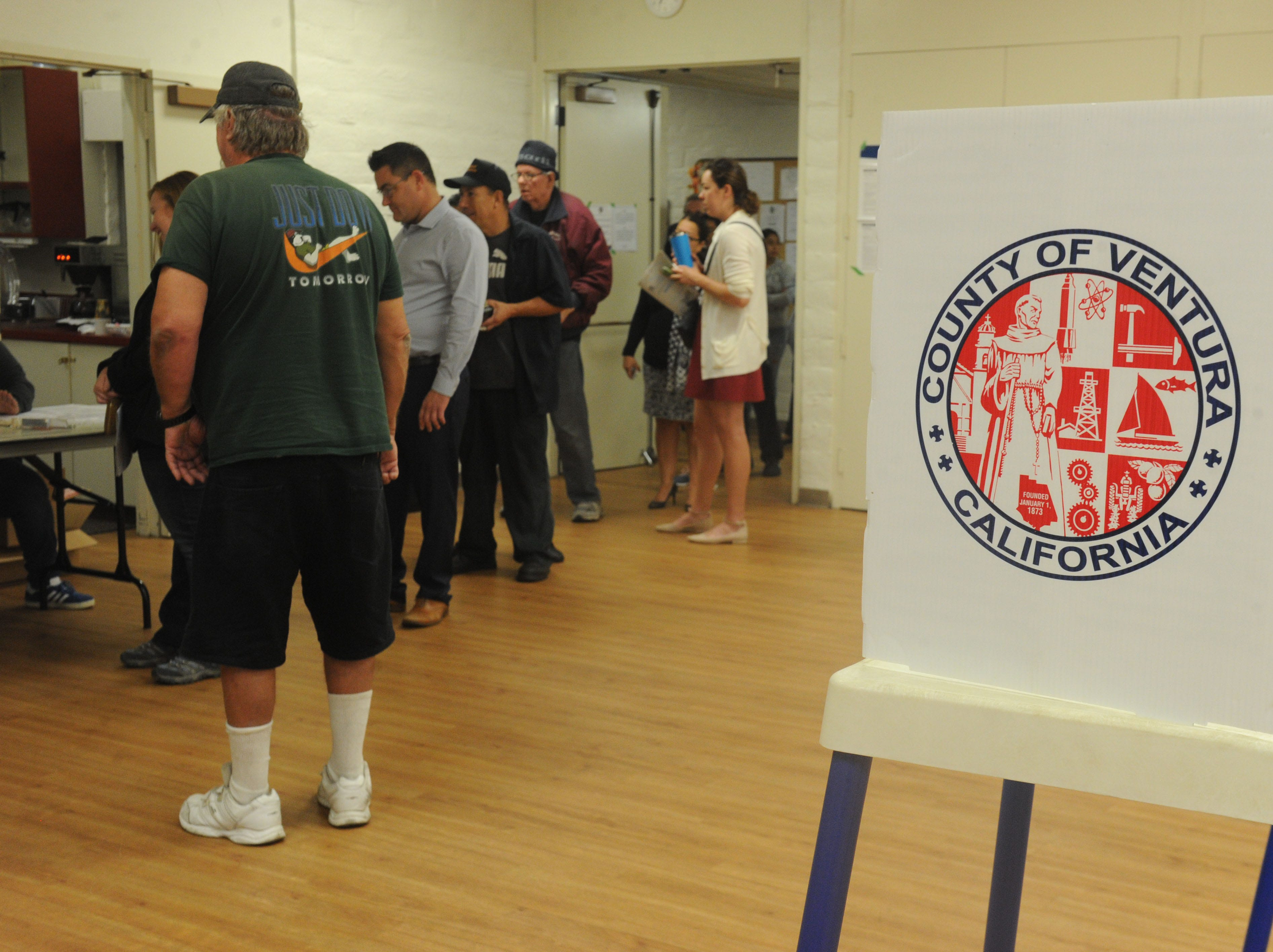 A group of people to start voting at Ventura Avenue Adult Center.