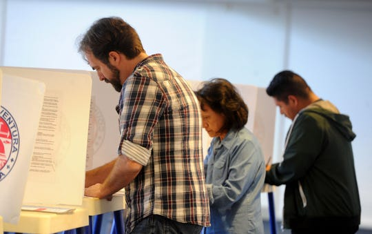 Angelo Mazzocco (left) votes at the Ronald Reagan Presidential Library & Museum in Simi Valley.