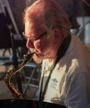 Dick Dodd plays the saxophone with the Ojai Band over the Fourth of July.
