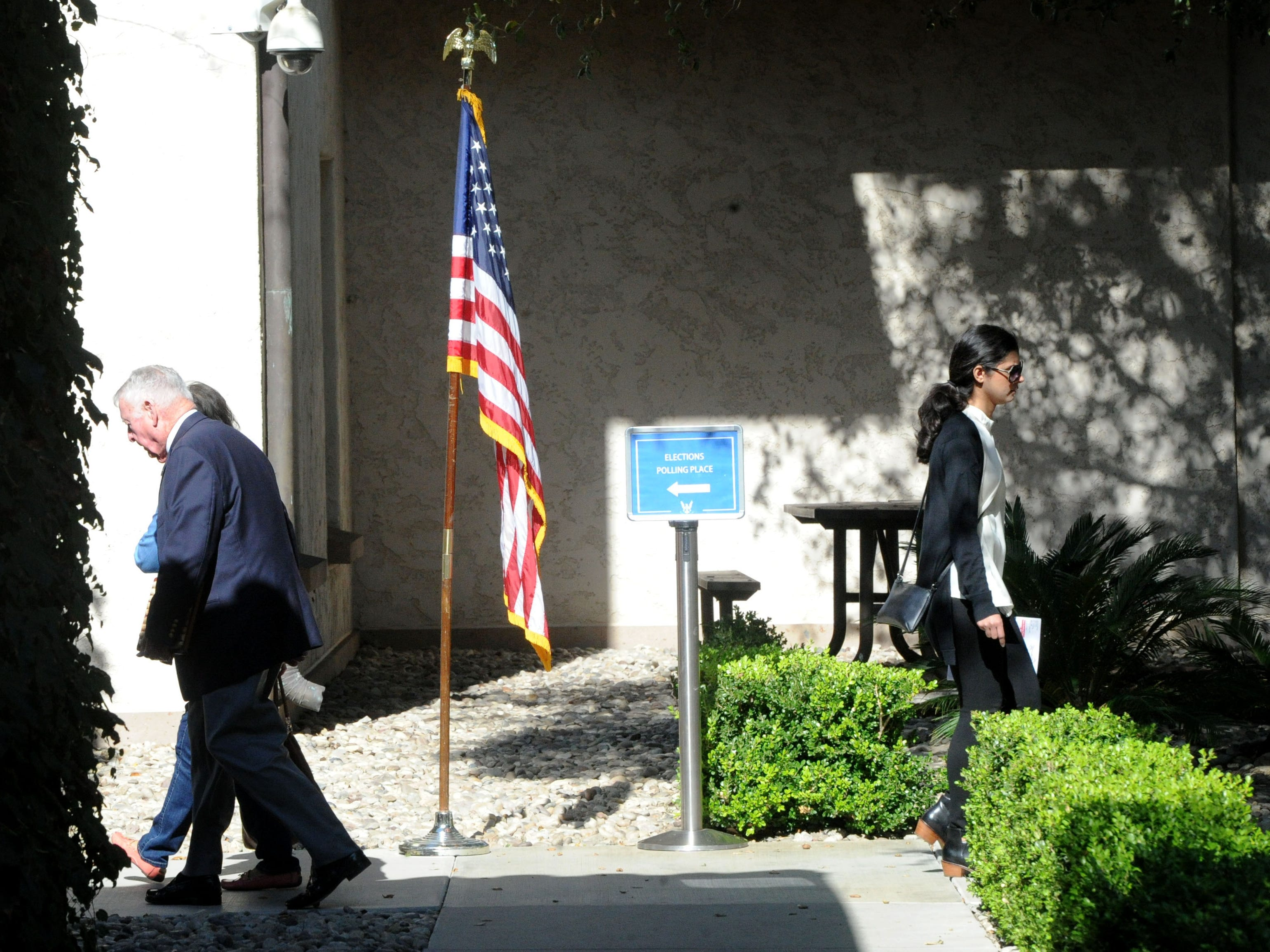 People make their way to the Ronald Reagan Presidential Library & Museum in Simi Valley on Tuesday. The library was a polling location.