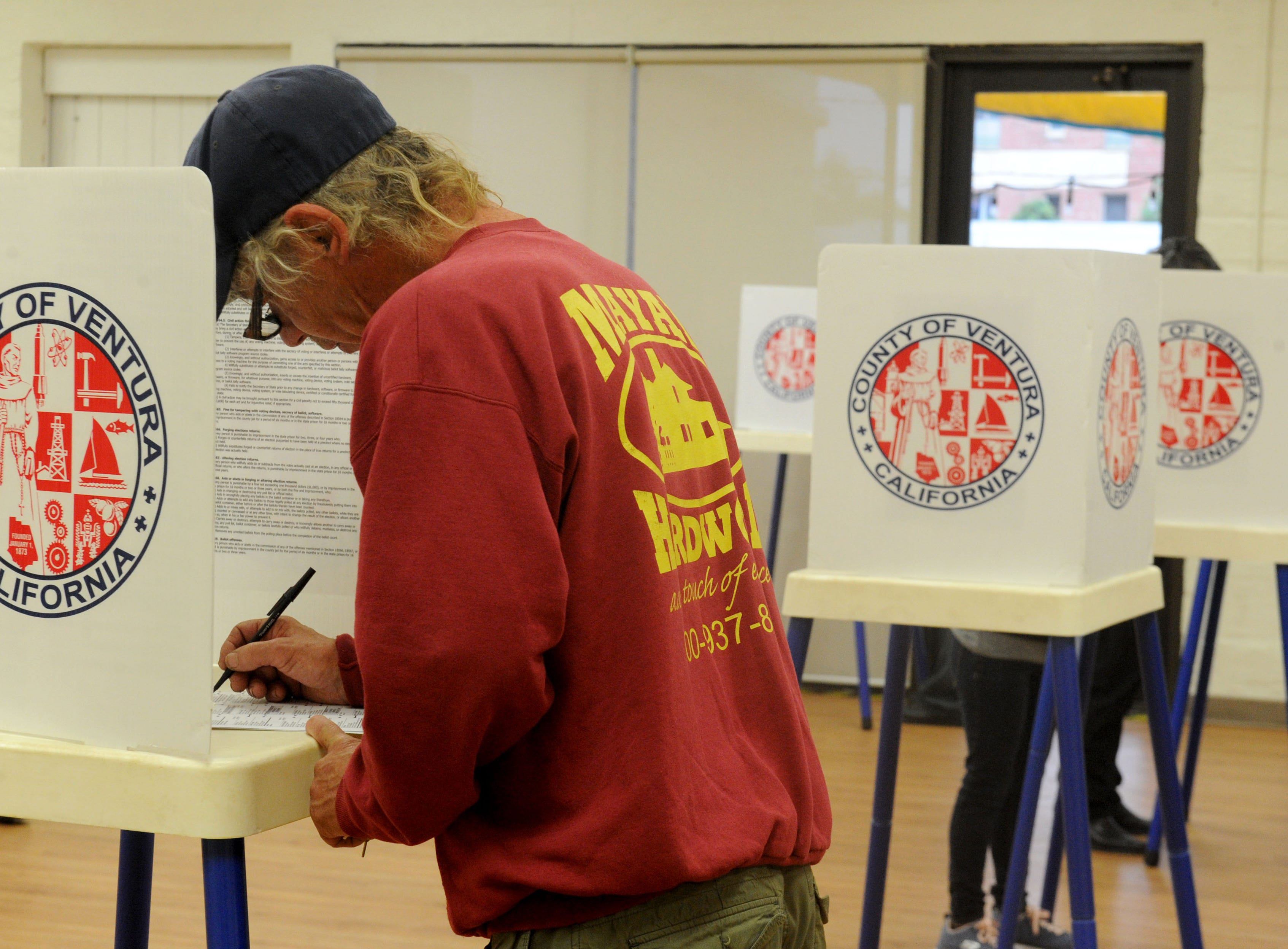 Russel Erickson votes in the morning at Ventura Avenue Adult Center. The center had a line of about 20 people.