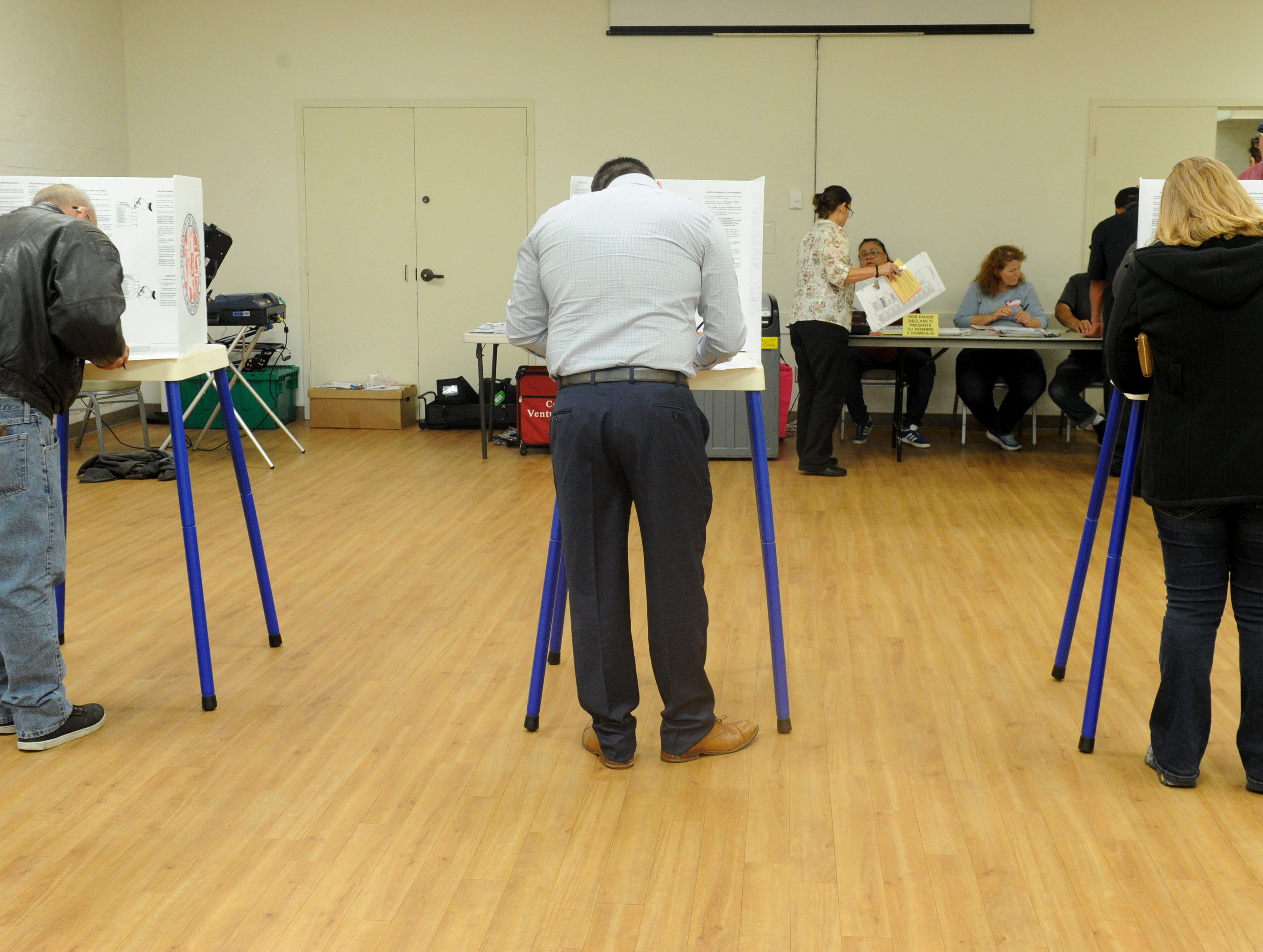 Voters fill out their ballots Tuesday at the Ventura Avenue Adult Center in Ventura.