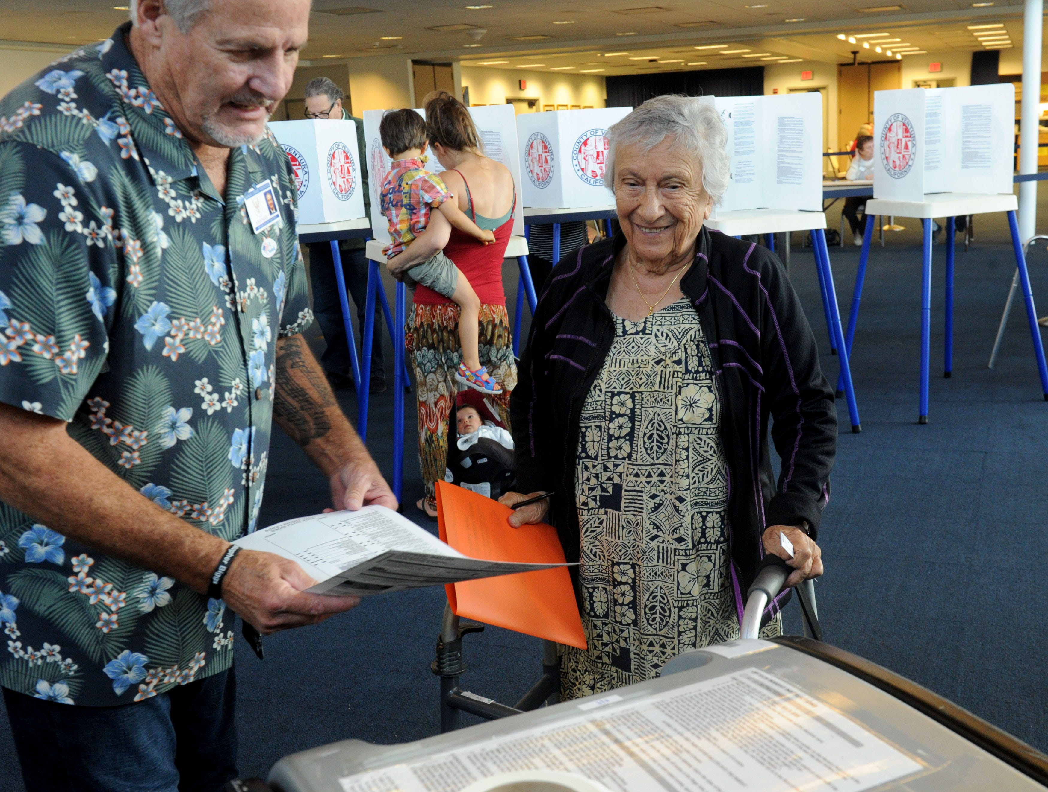 John Biggs, an inspector at polling places, helps Mary Pavia cast her vote Tuesday at the Ronald Reagan Presidential Library & Museum in Simi Valley. The library had a steady stream of voters.