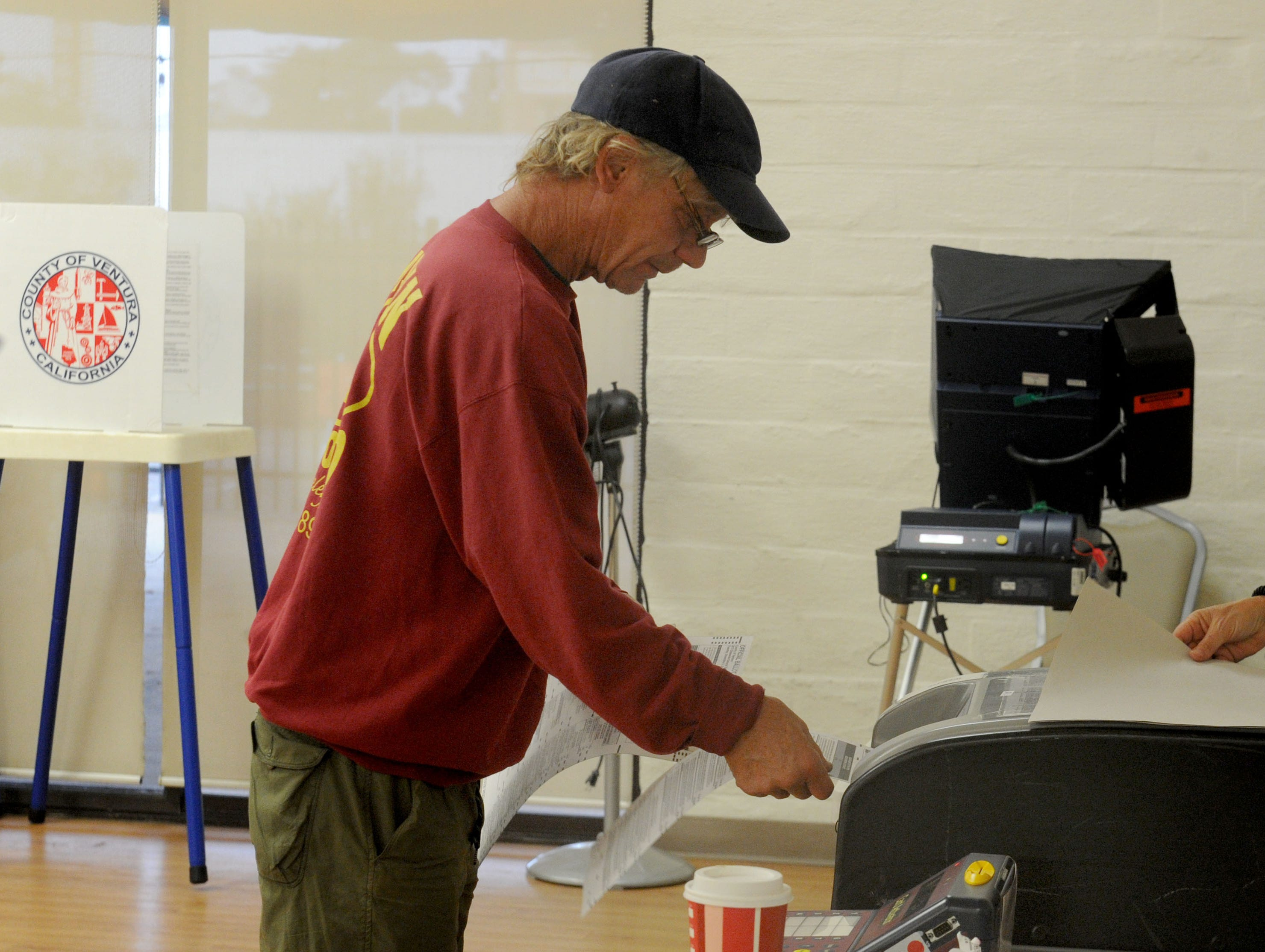 Russel Erickson votes at the Ventura Avenue Adult Center in Ventura on Tuesday morning. The center had a line of about 20 people.