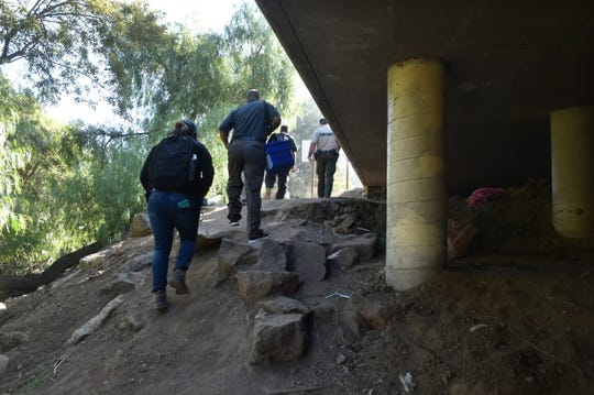 Members of an outreach program from Ventura County Medical Center and other local agencies search along Highway 101 in Thousand Oaks for transients in need of vaccines, check-ups and social services. The group also goes to areas around the Santa Clara and Ventura rivers.