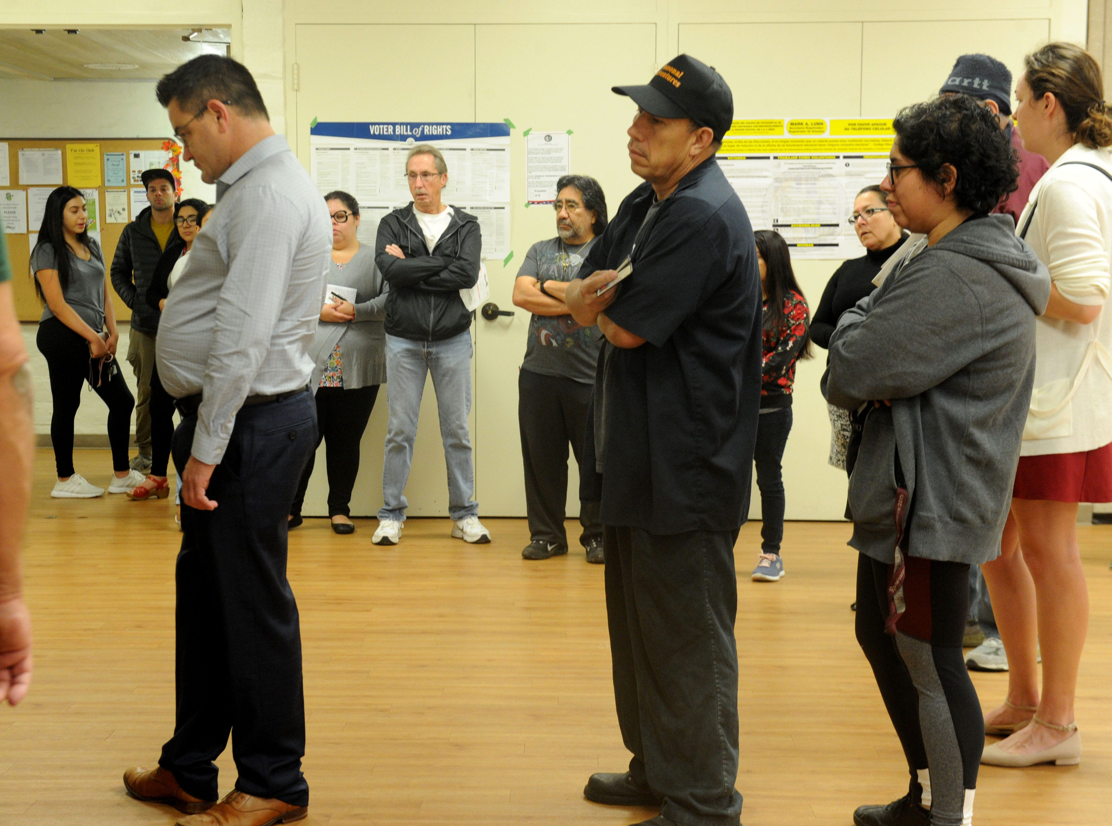People wait to vote Tuesday morning at the Ventura Avenue Adult Center.
