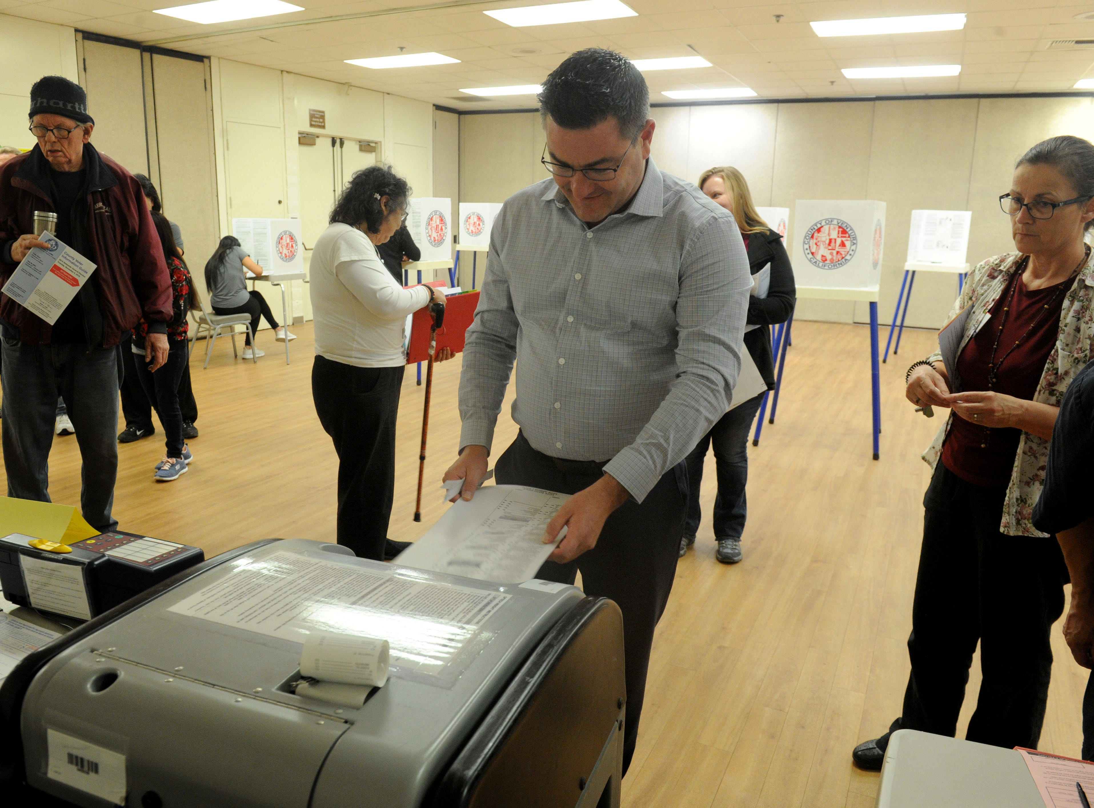 John Wilner finishes voting in the morning at Ventura Avenue Adult Center. The center had a line of about 20 people.