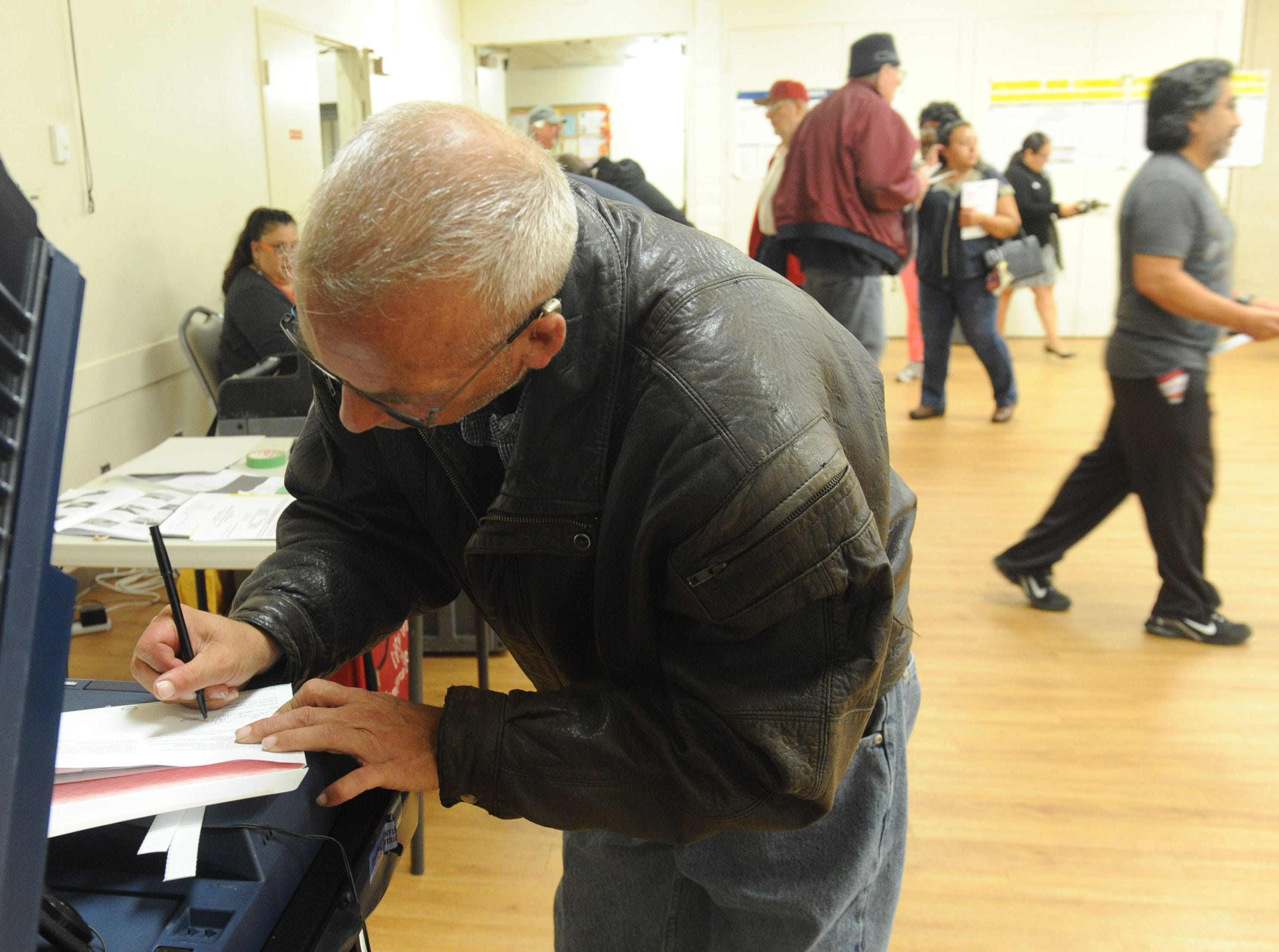 Steven Bienvenu (cq) was the first person to vote in the morning at Ventura Avenue Adult Center. The center had a line of about 20 people.