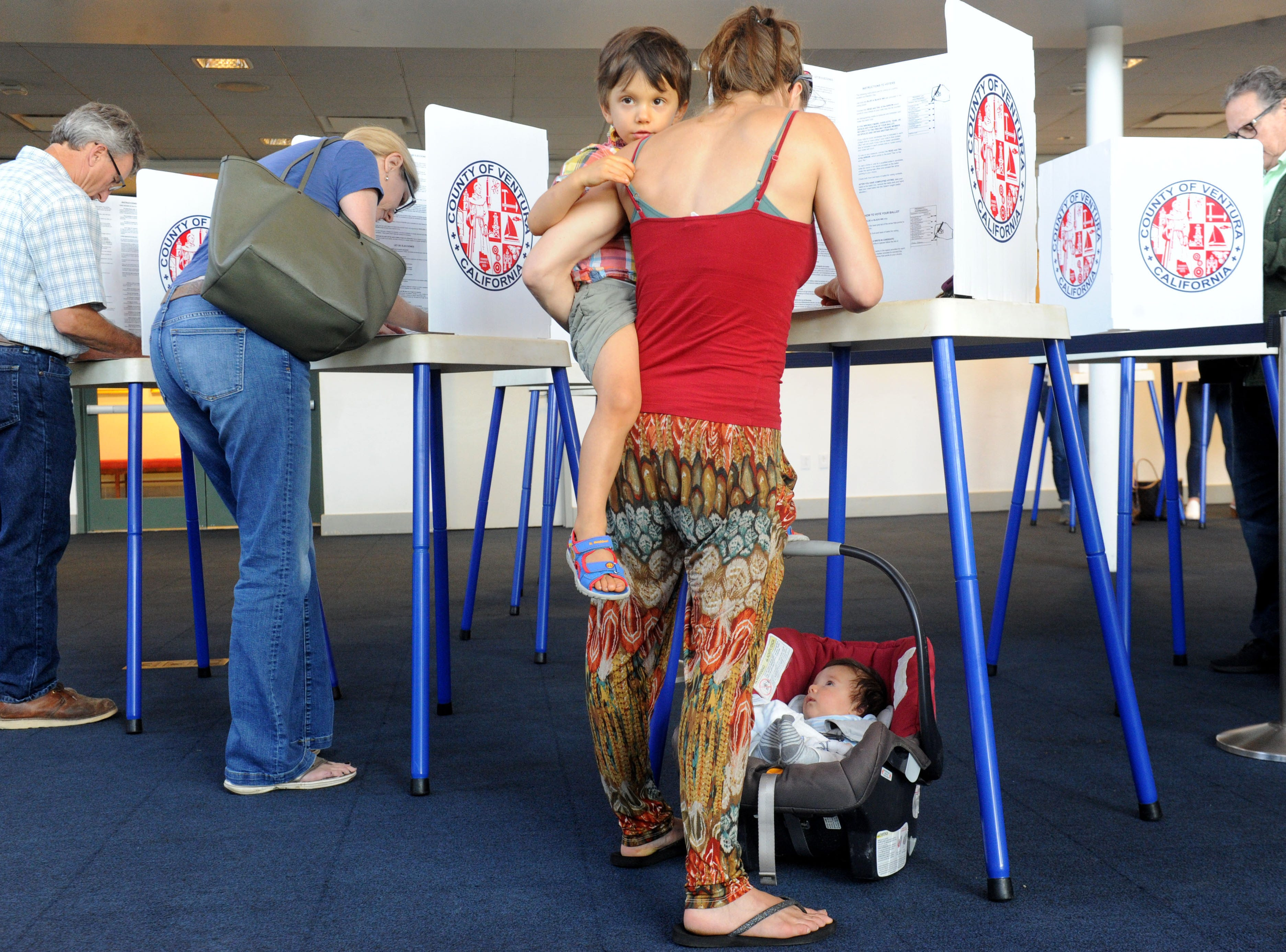 Ana Alvarez votes with her children Max Alvarez, 3, and Oliver Alvarez, 2 months, at the Ronald Reagan Presidential Library & Museum in Simi Valley. The library had a steady stream of voters Tuesday.