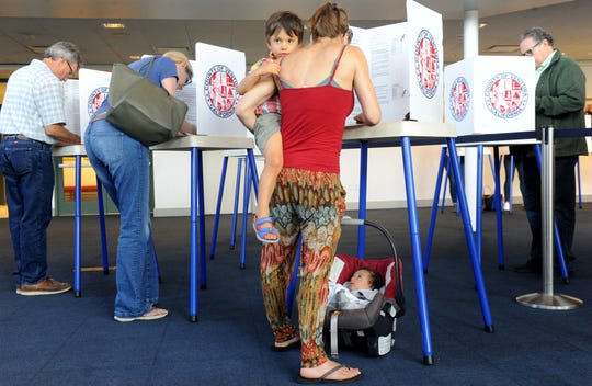 Ana Alvarez votes with her children Max Alvarez, 3, and Oliver Alvarez, 2 months, at the Ronald Reagan Presidential Library & Museum in Simi Valley in this file photo.