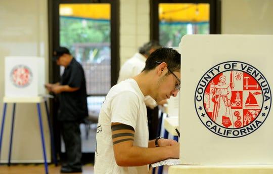 Cristian Barba votes at Ventura Avenue Adult Center in Ventura in this file photo.