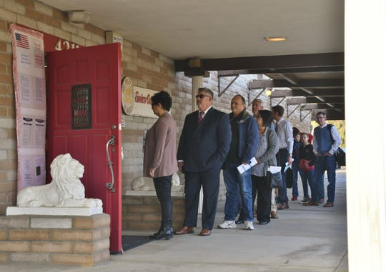 Voters wait to cast their ballot at Visalia's Sons of Italy on Tuesday, Nov. 6.