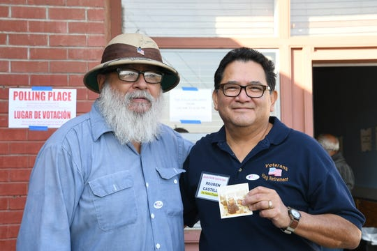 "Vietnam veterans Reuben Castillo (pictured left) and Antonio Espinosa (pictured right) reconnect at the Anthony Community Center precinct. Espinosa met Castillo's brother in 1971 in Saigon on their way back home from military service. Castillo says he was ""in tears"" when Espionosa surprised him with photos of himself and his brother at the polling place."