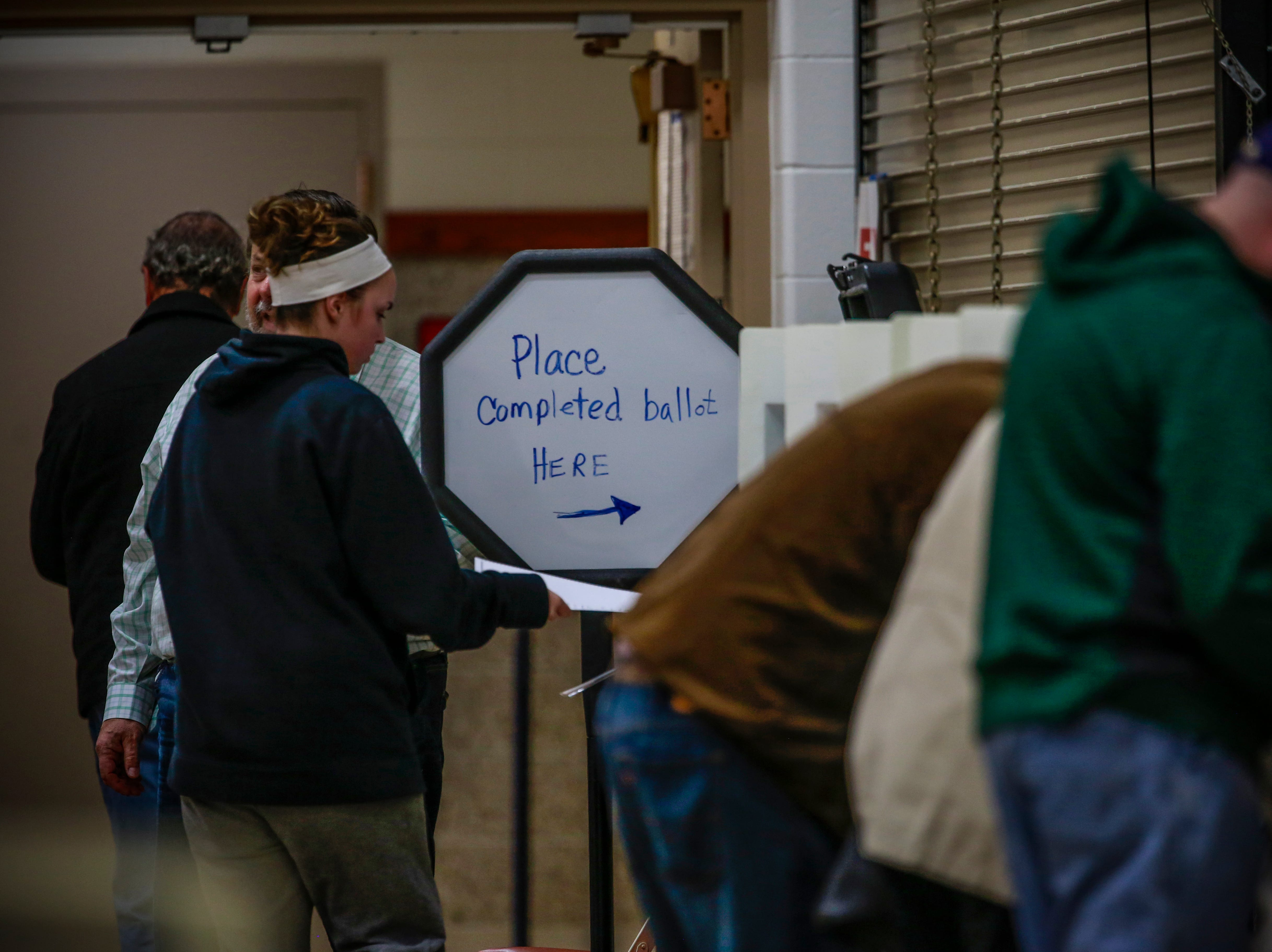 A voter feeds her ballot to a counting machine Tuesday, Nov. 6, 2018, at Wausau East High School gymnasium in Wausau, Wis. T'xer Zhon Kha/USA TODAY NETWORK-Wisconsin