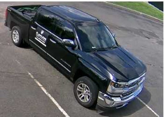 "Marathon County Crime Stoppers is investigating a home improvement scam. The male identified himself as Joseph Stevens when he cashed the victim's check for roof work that was not completed. The name on the homeowner-signed contract was FLAWLESS (Masonry, Paving, Sealing). As pictured here, the male was driving a black four-door Chevy Silverado, with ""FLAWLESS"" on the back passenger door."