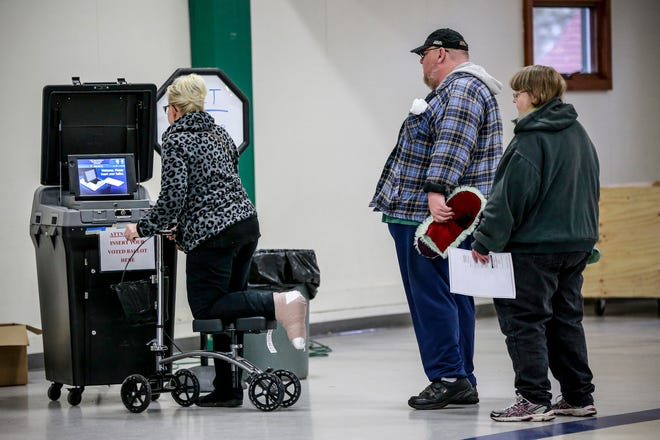 Voters in line to feed their ballots Tuesday, Nov. 6, 2018, at the Youth Building in Marathon Park in Wausau, Wis. T'xer Zhon Kha/USA TODAY NETWORK-Wisconsin