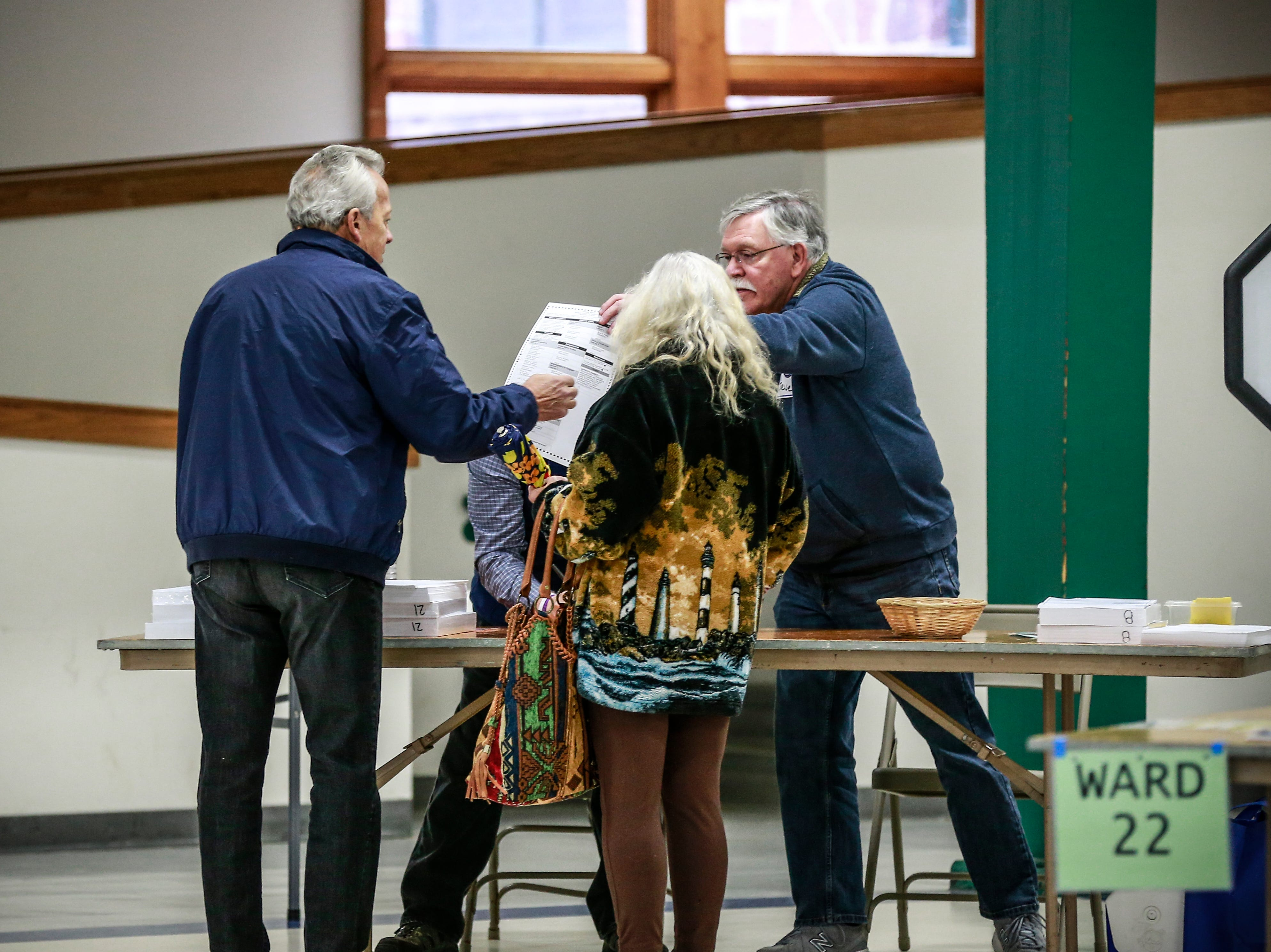 Voters receive their ballots Tuesday, Nov. 6, 2018, at the Youth Building in Marathon Park in Wausau, Wis. T'xer Zhon Kha/USA TODAY NETWORK-Wisconsin