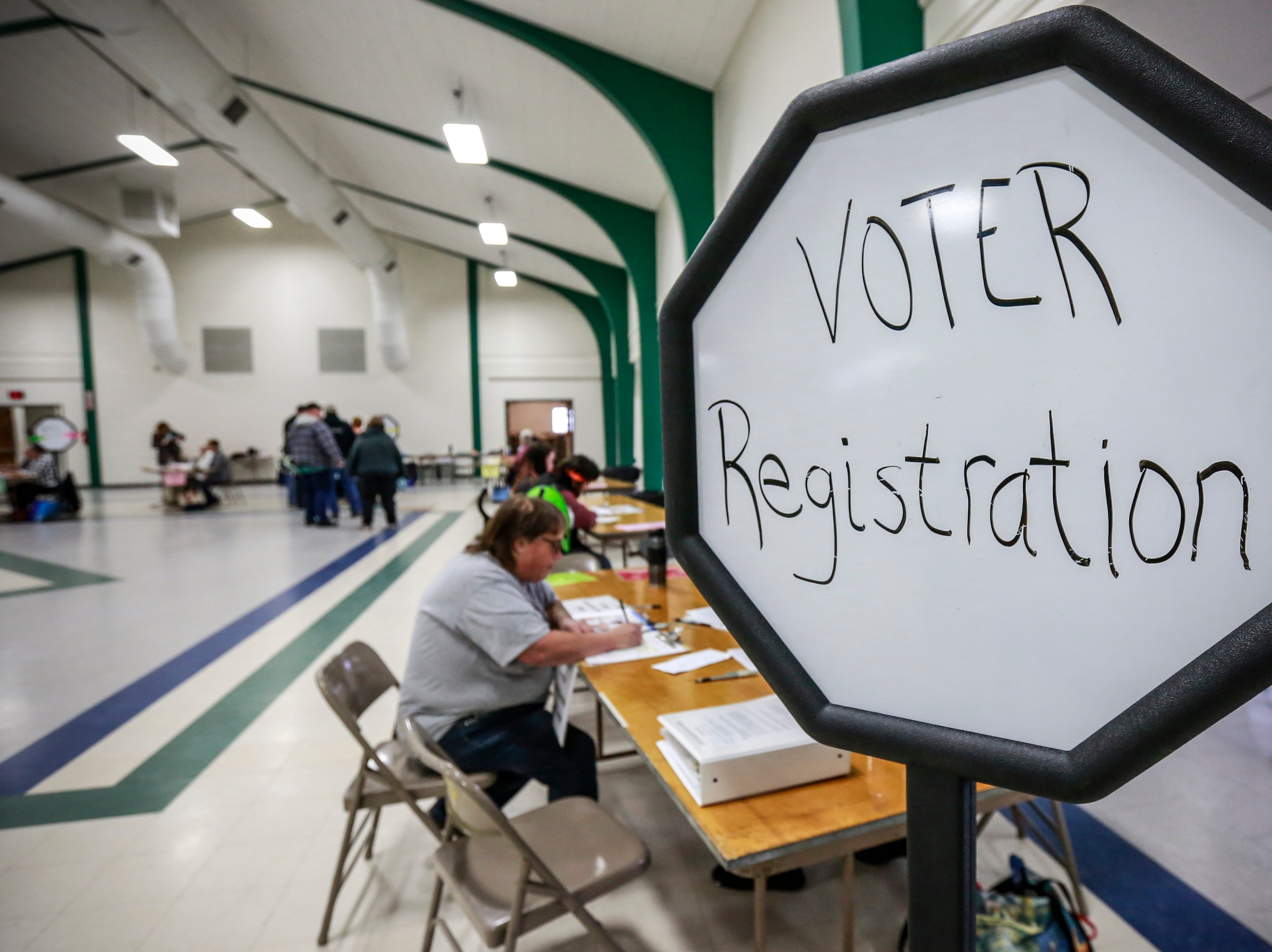 """A """"Voter Registration"""" sign displays at the entrance Tuesday, Nov. 6, 2018, at the Youth Building in Marathon Park in Wausau, Wis. T'xer Zhon Kha/USA TODAY NETWORK-Wisconsin"""