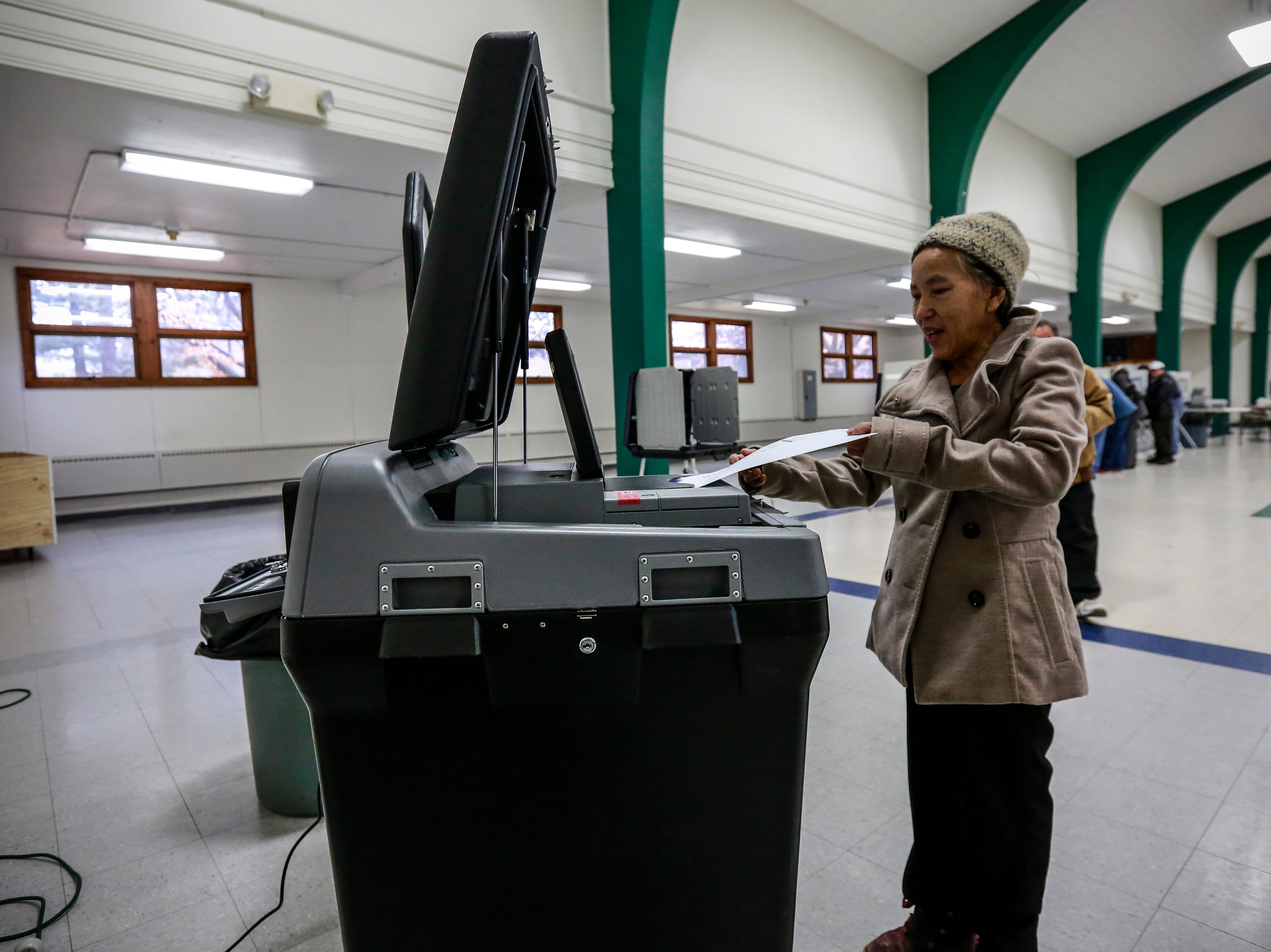 Youa Yang of Wausau feeds her ballot to a counting machine Tuesday, Nov. 6, 2018, at the Youth Building in Marathon Park in Wausau, Wis. T'xer Zhon Kha/USA TODAY NETWORK-Wisconsin