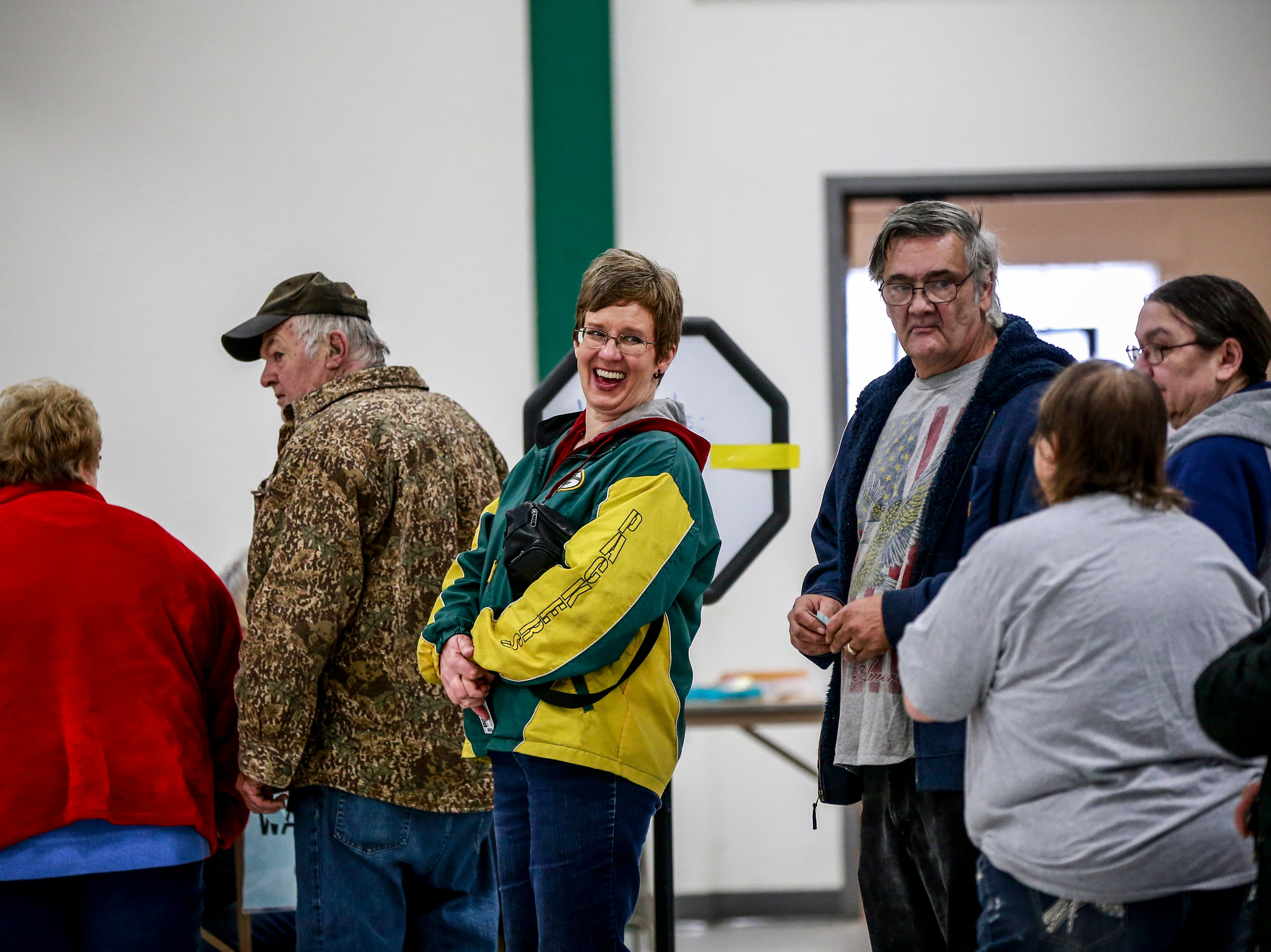 Voters mingle as they line up to register for their voting ballots Tuesday, Nov. 6, 2018, at the Youth Building in Marathon Park in Wausau, Wis. T'xer Zhon Kha/USA TODAY NETWORK-Wisconsin