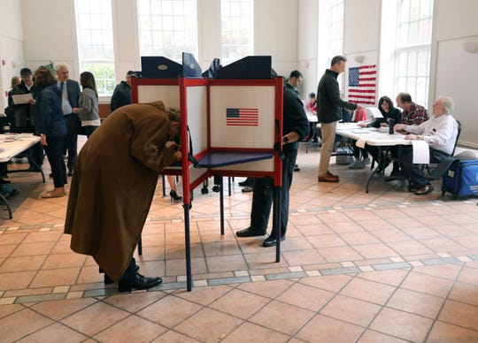 Voters fill in ballots at the Presbyterian Church of Mount Kisco on Nov. 6, 2018.
