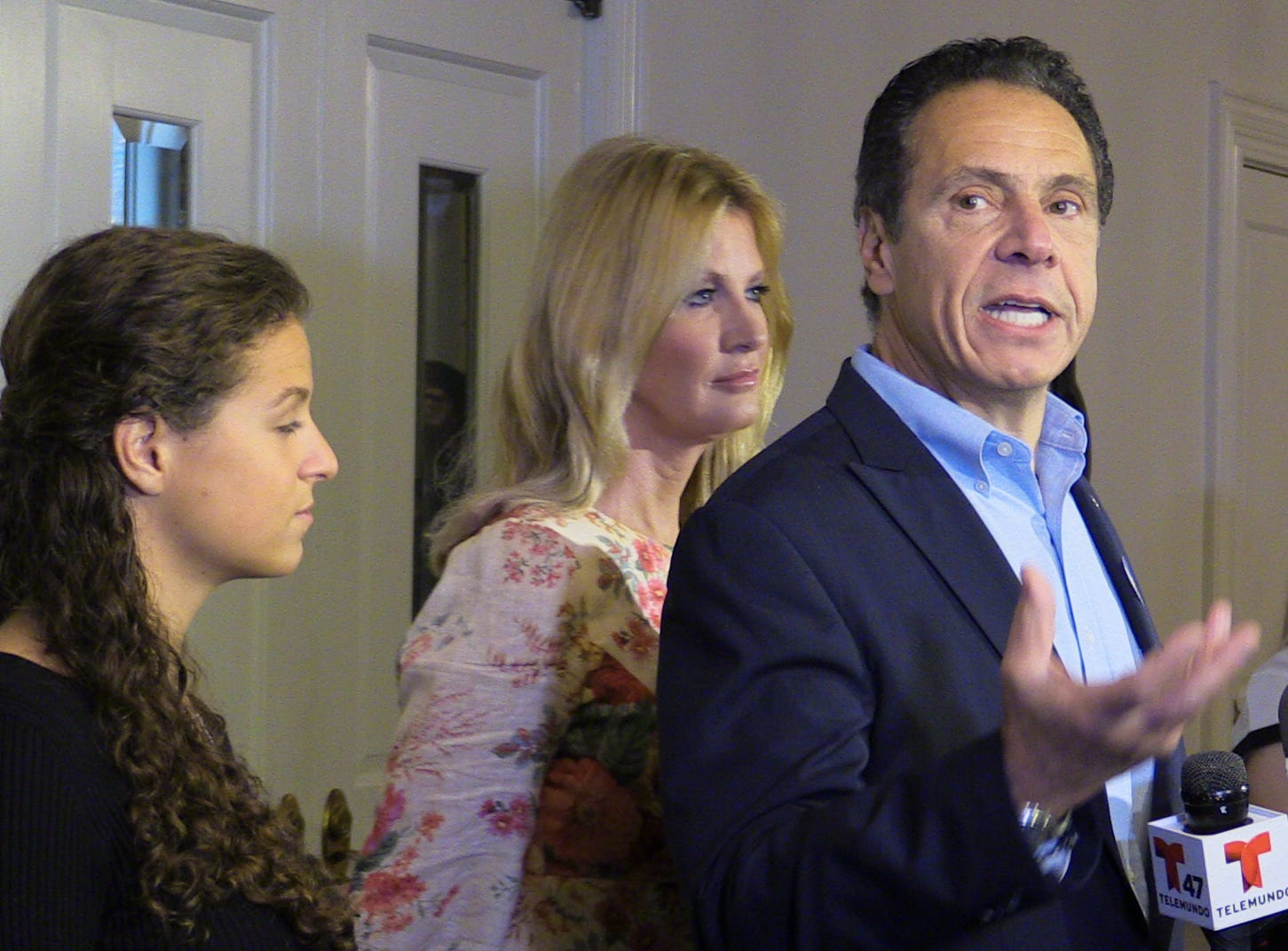 New York Governor Andrew Cuomo speaks to the media after voting at the Presbyterian Church of Mount Kisco, Nov. 6, 2018. With him are at left, daughter Cara Kennedy Cuomo and girlfriend Sandra Lee.
