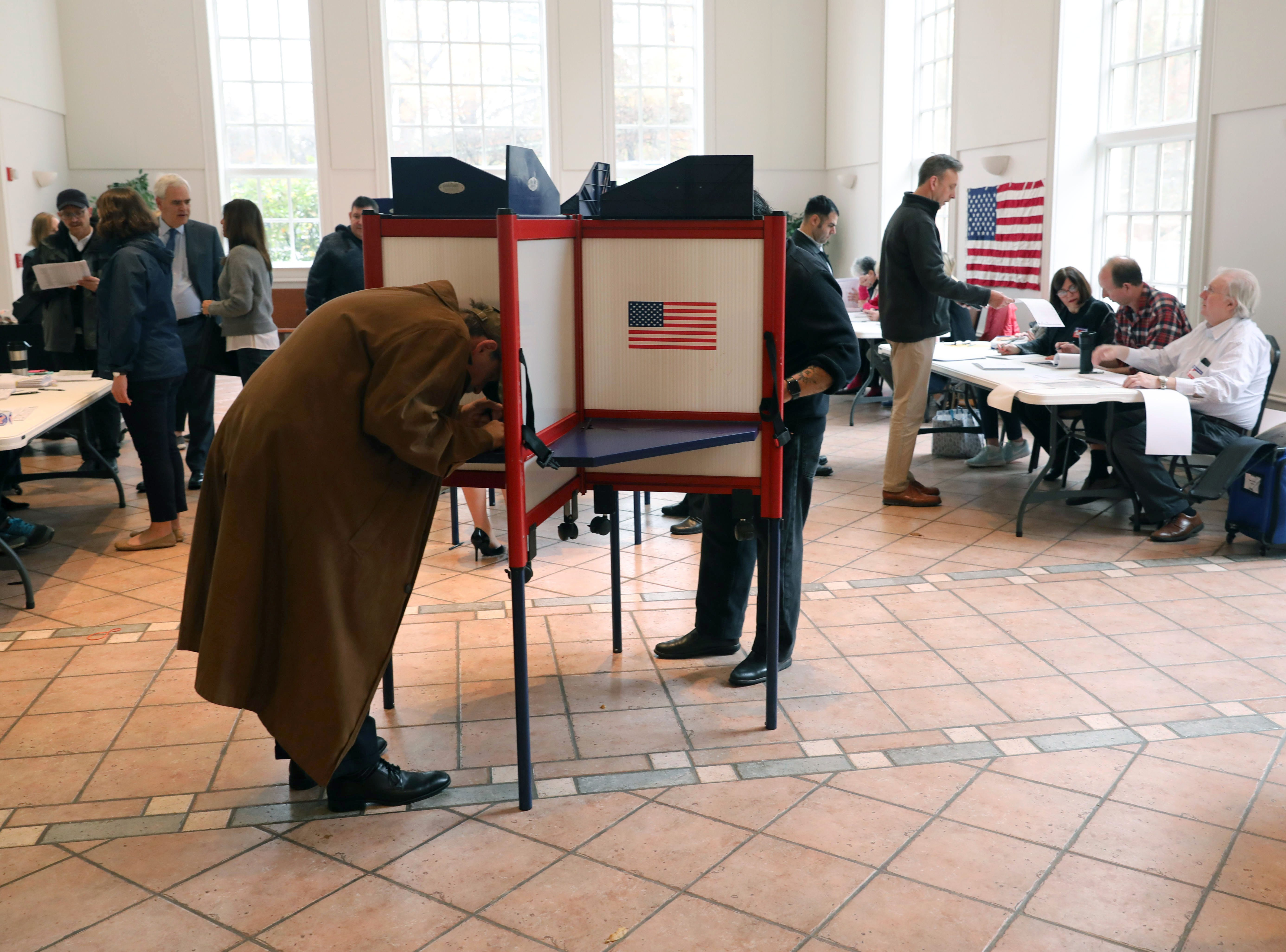 Voters fill in their ballots at the Presbyterian Church of Mount Kisco, Nov. 6, 2018.
