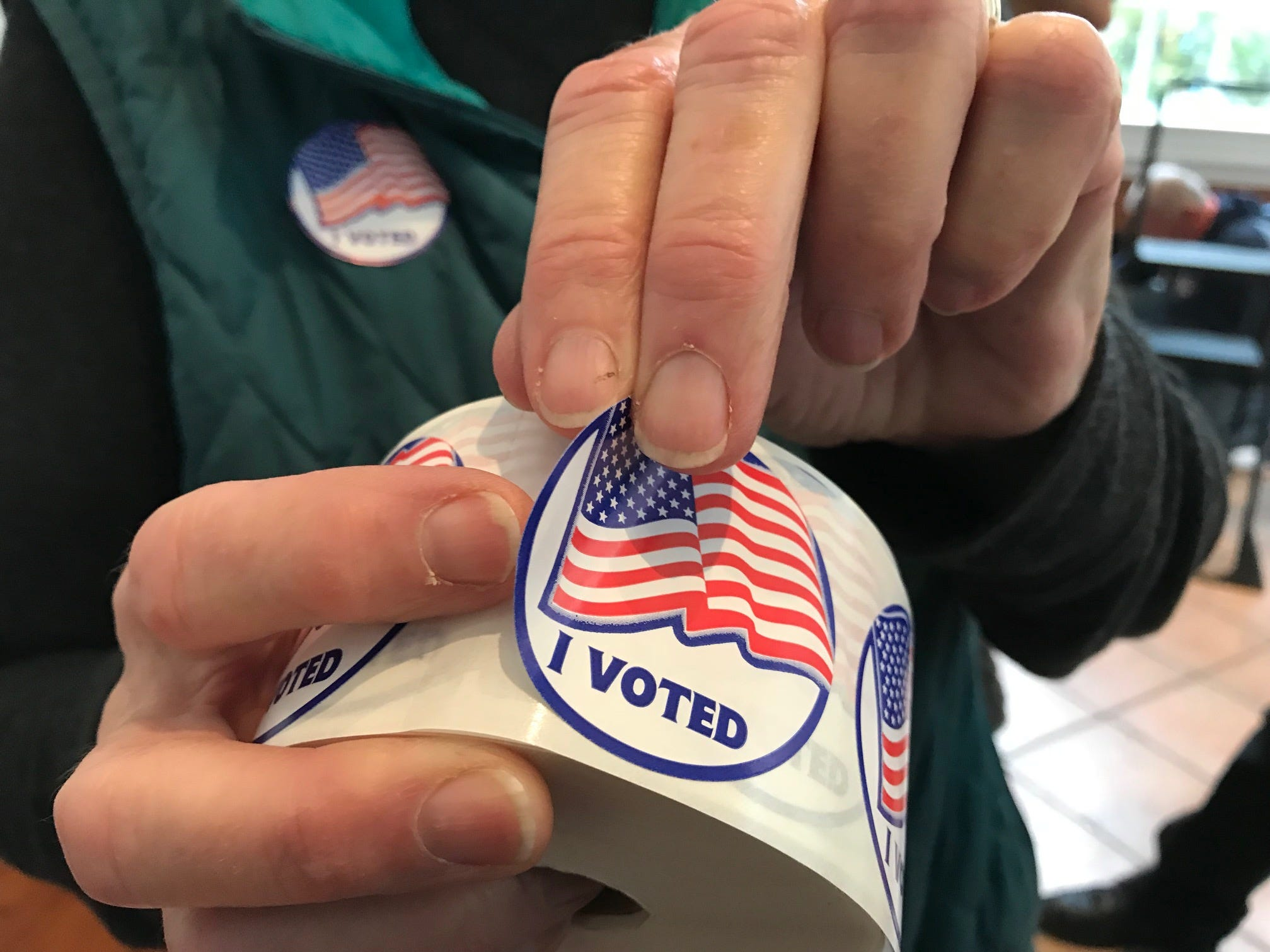 "An ""I voted"" sticker is peeled off a roll Tuesday."