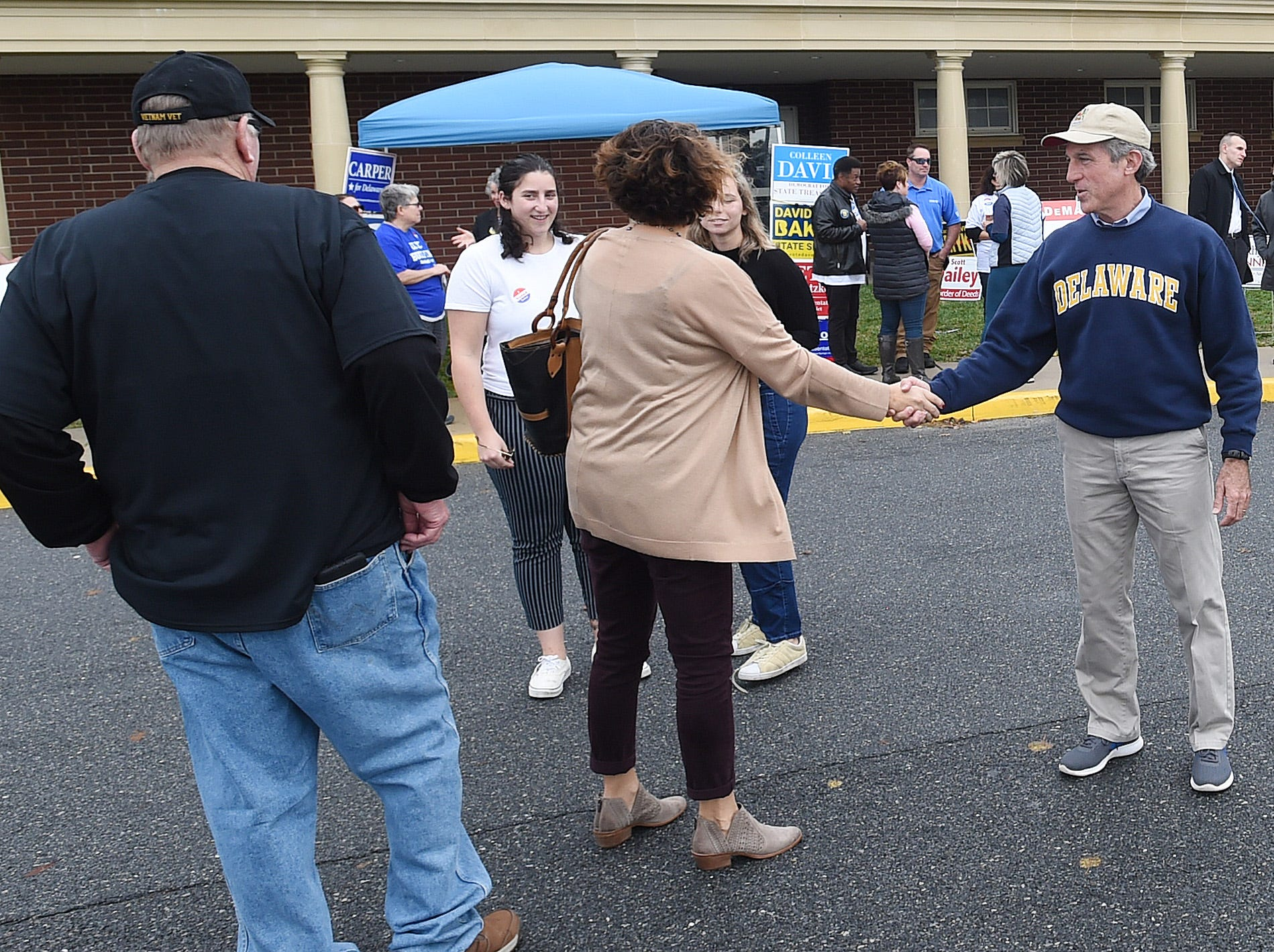 Delaware Governor John Carney greets voters at Cape Henlopen High School near Lewes as turnout in eastern Sussex County has been steady at polling places as candidates still seek supporters for their support.