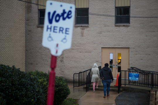 People head in to vote at the Holy Trinity Greek Orthodox Church on Tuesday, Nov. 6, 2018, in Wilmington.