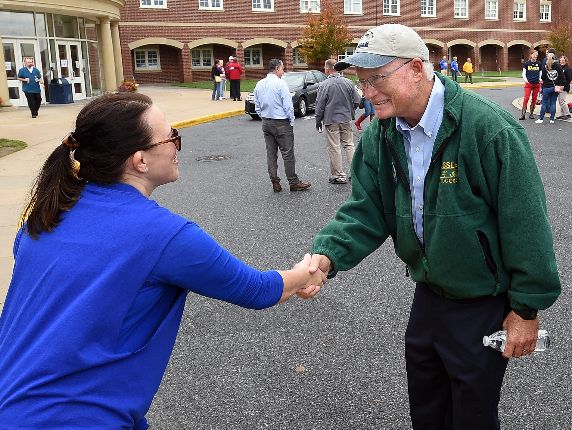 Dave Baker candidate for State Senate greets voters at Cape Henlopen High School near Lewes as turnout in eastern Sussex County has been steady at polling places as candidates still seek supporters for their support. Special to the News Journal / CHUCK SNYDER