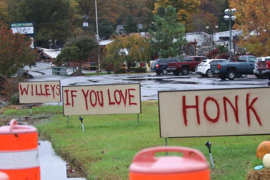 Willey Farms that was destroyed by a devastating fire Monday morning put out signs for loyal customers to honk to show their love of the popular longtime farm market in Townsend.