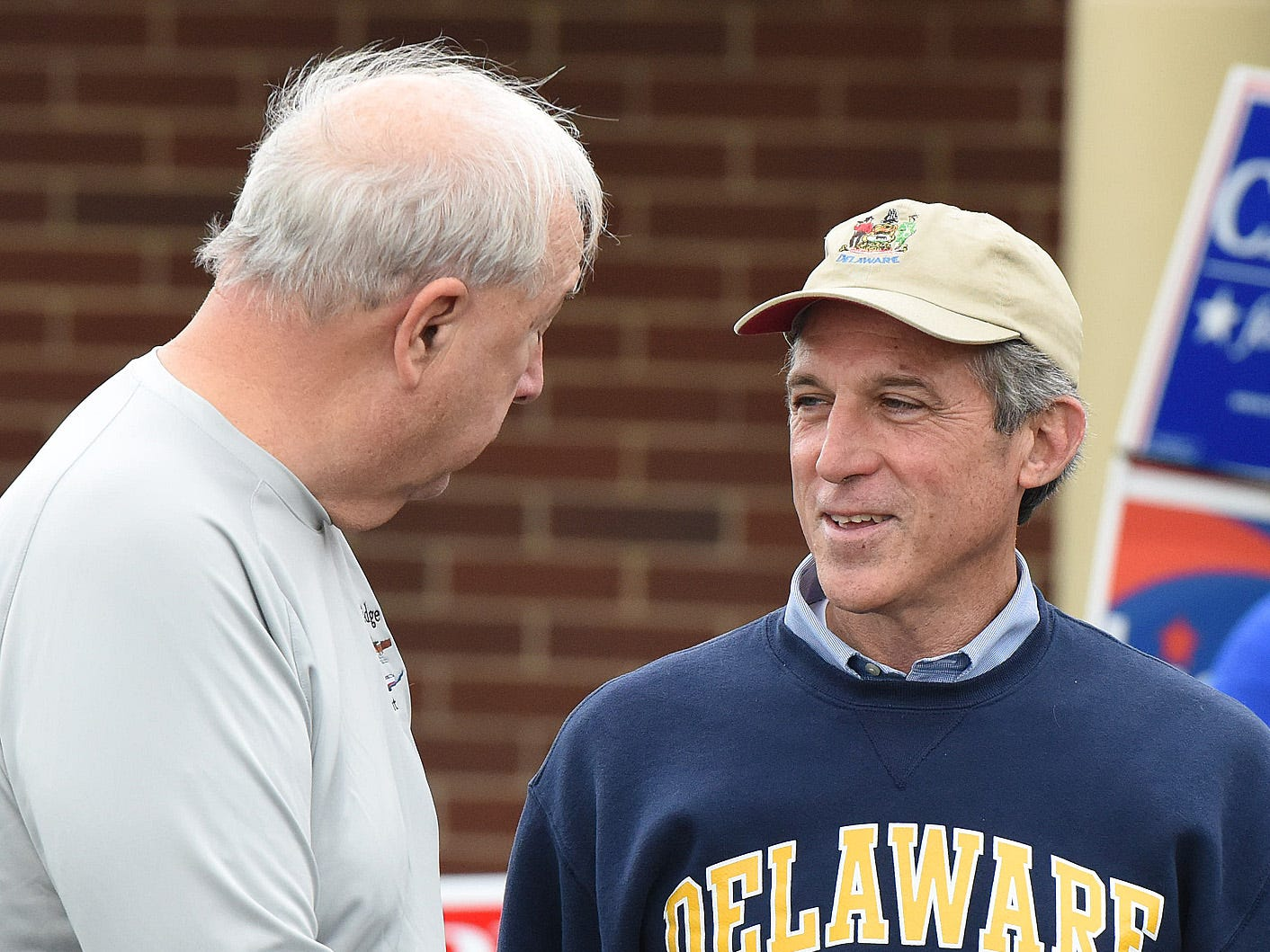 Gov. John Carney greets voters at Cape Henlopen High School near Lewes as turnout in eastern Sussex County has been steady at polling places as candidates still seek supporters for their support.