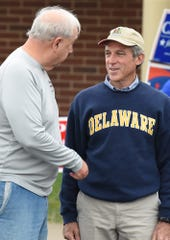 Gov. John Carney greets voters at Cape Henlopen High School near Lewes on Tuesday.
