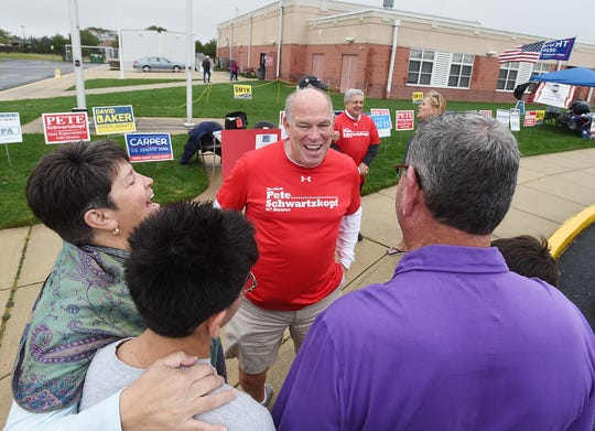 House Speaker Pete Schwartzkopf greets voters at Beacon Middle School near Angola Tuesday morning.