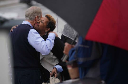 Sen. Tom Carper gets a hug from a supporter before he cast his midterm votes at P.S. duPont Middle School on Tuesday.