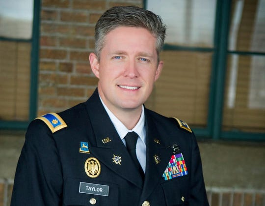 This undated photo provided by the Utah National Guard shows Maj. Brent Taylor of the Utah National Guard. Taylor, former mayor of North Ogden, died in Afghanistan on Saturday, Nov. 3, 2018, City Councilman Phillip Swanson said. Taylor was deployed to Afghanistan in January with the Utah National Guard for what was expected to be a 12-month tour of duty. Taylor previously served two tours in Iraq and one tour in Afghanistan. (Courtesy of Utah National Guard via AP)