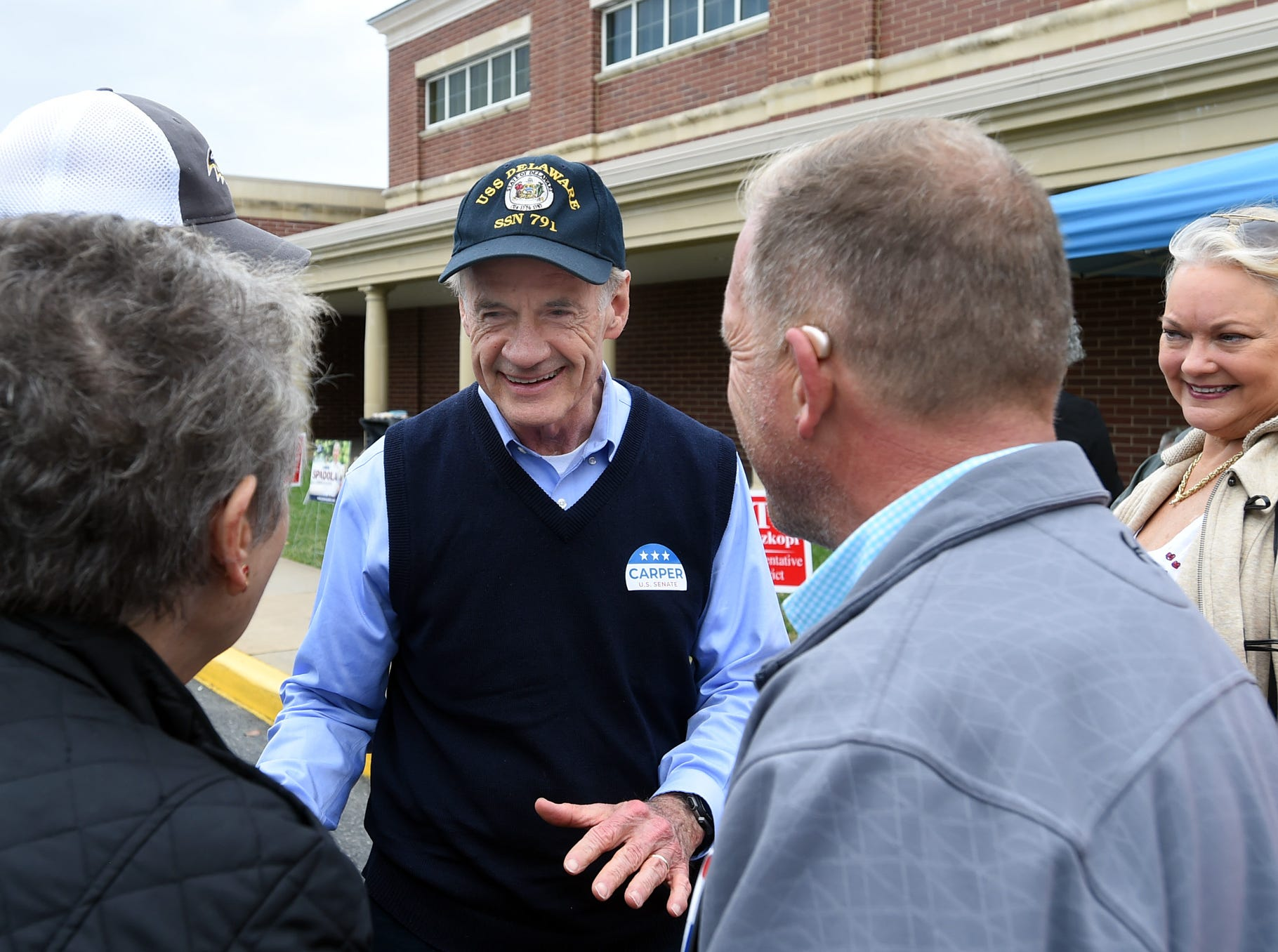 U.S. Senator Tom Carper greets voters at Cape Henlopen High School near Lewes as turnout in eastern Sussex County has been steady at polling places as candidates still seek supporters for their support. Special to the News Journal / CHUCK SNYDER