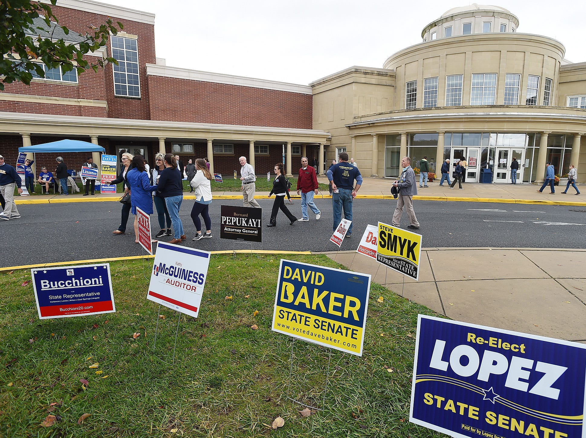 Voters head to the pools at Cape Henlopen High School near Lewes as turnout in eastern Sussex County has been steady at polling places as candidates still seek supporters for their support.