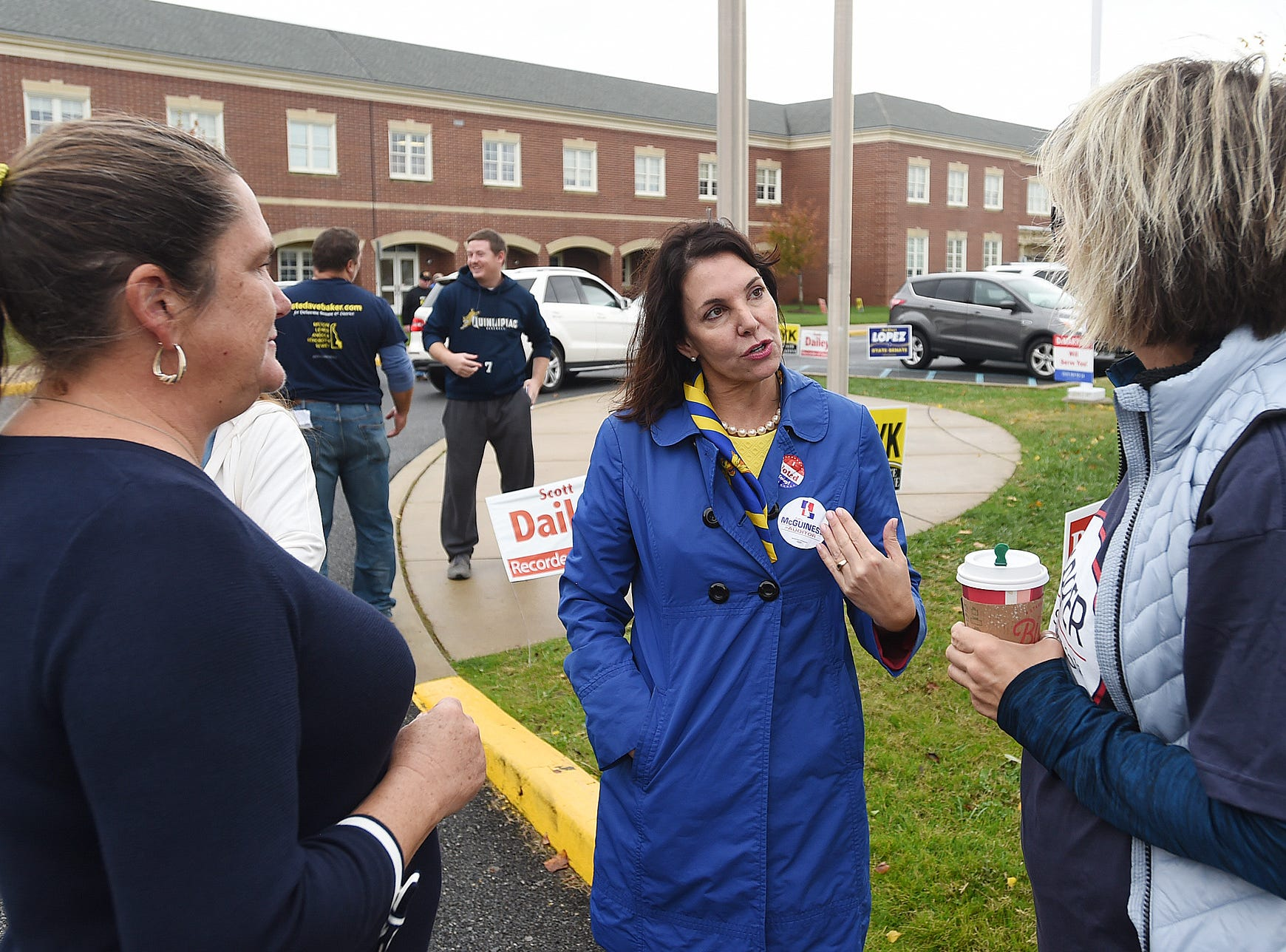 State Auditor candidate Kathy McGuiness greets voters at Cape Henlopen High School near Lewes as turnout in eastern Sussex County has been steady at polling places as candidates still seek supporters for their support.