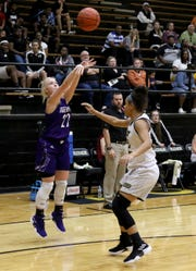 Jacksboro's Jordan Nichols shoots from three-point range over Rider's Jaelyn White Monday, Nov. 5, 2018, at Rider.