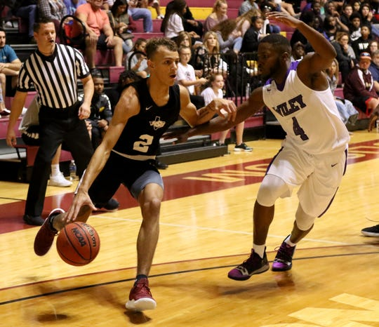 Midwestern State's Trae Jones dribbles by Wiley's Martavious Washington Monday, Nov. 5, 2018, in D.L. Ligon Coliseum at MSU. The Mustangs lost to the Wildcats 78-64.