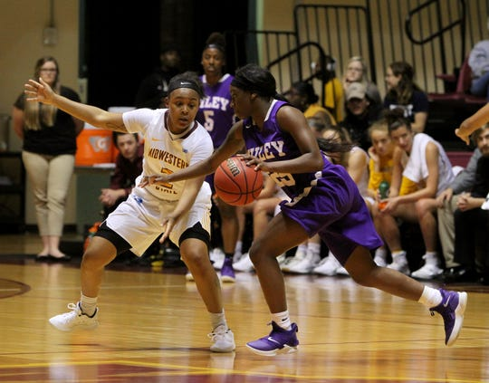 Midwestern State's Chelcie Kizart guards Wiley College's Jaida Carson Monday, Nov. 5, 2018, in D.L. Ligon Coliseum at MSU. The Mustangs defeated the Wildcats 91-63.