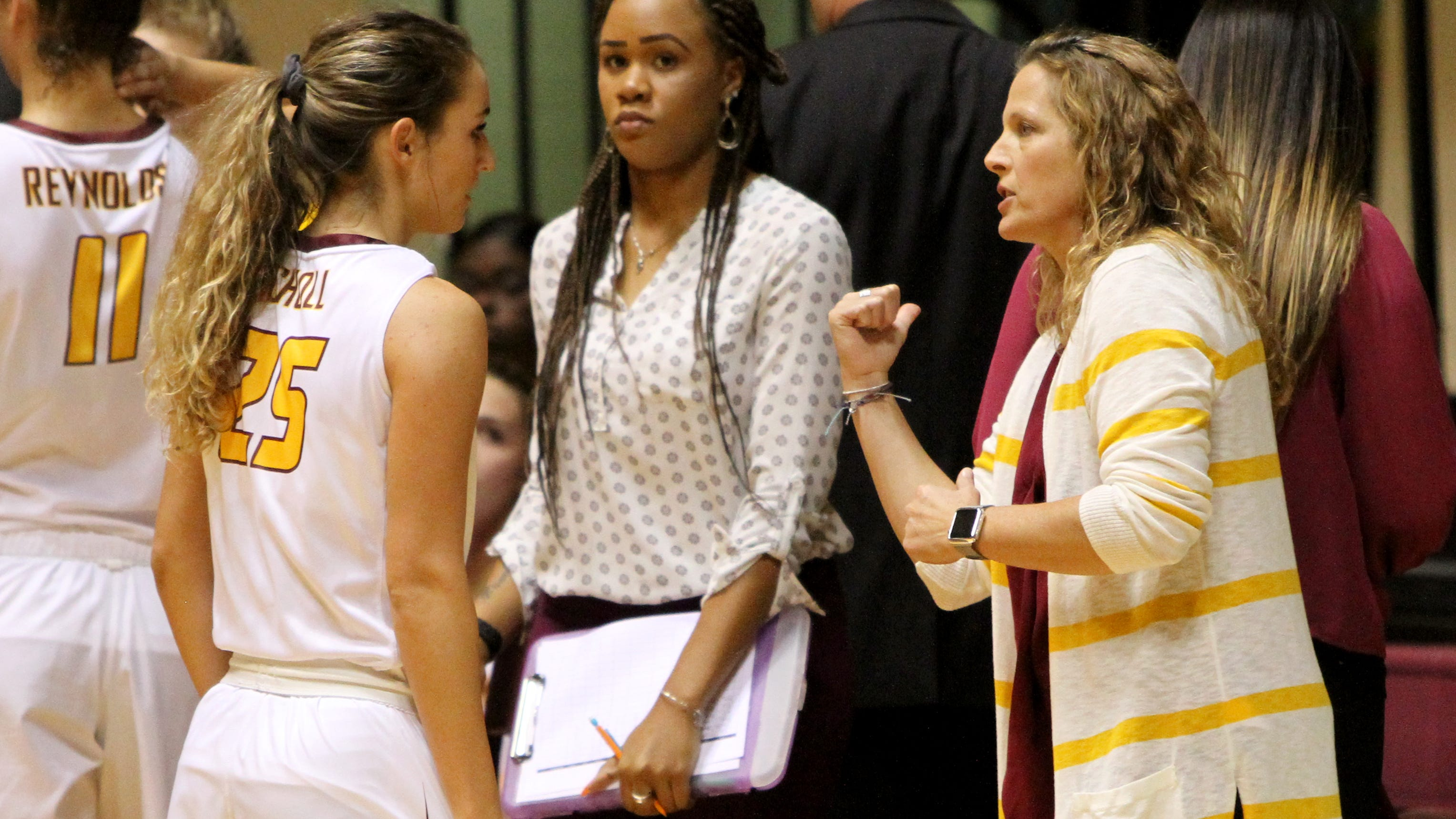Midwestern State's Anni Scholl talks to head basketball coach Noel Johnson during a timeout in the game against Wiley College Monday, Nov. 5, 2018, in D.L. Ligon Coliseum at MSU. The Mustangs defeated the Wildcats 91-63.