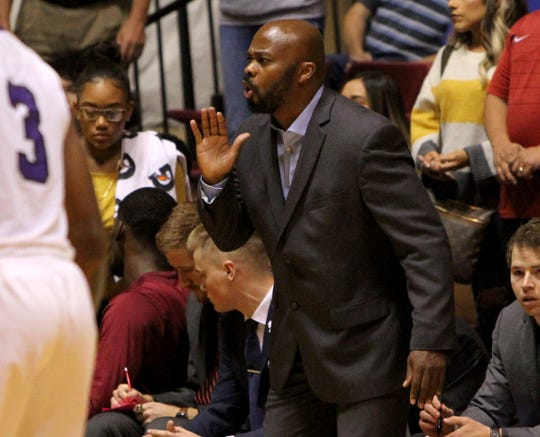 Midwestern State head basketball coach Nelson Haggerty gives directions to his players in the game against Wiley Monday, Nov. 5, 2018, in D.L. Ligon Coliseum at MSU. The Mustangs lost to the Wildcats 78-64.