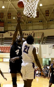 Midwestern State's Dorian Chatman shoots over Wiley's Traylin Prejean Monday, Nov. 5, 2018, in D.L. Ligon Coliseum at MSU. The Mustangs lost to the Wildcats 78-64.