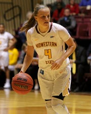 Midwestern State's Mica Schneider dribbles in the game against Wiley College Monday, Nov. 5, 2018, in D.L. Ligon Coliseum at MSU. The Mustangs defeated the Wildcats 91-63.