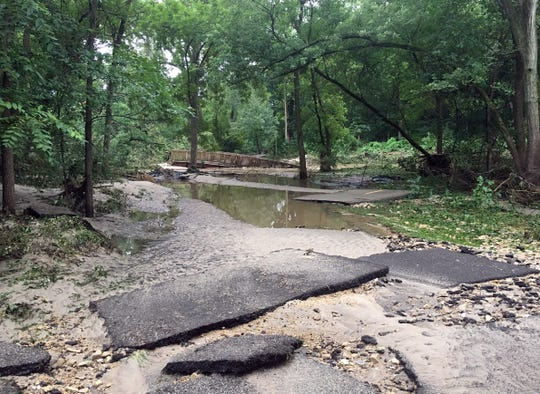 Flooding in August and September 2018 caused over $200 million in damages in Wisconsin and set the stage for unseasonably high numbers of floodwater mosquitoes late in the season. This photo, taken on Aug. 21, 2018, shows standing water along a damaged bicycle path in Middleton.