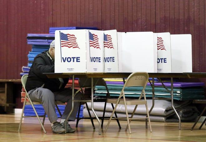A resident votes at the Zanesville Civic League Civic Center in Zanesville in the Times Recorder file photo. The center hosts the fourth precinct of Zanesville.